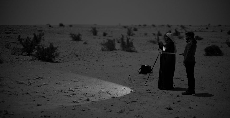 Khalid Al-Thani and me working by the moon light in Qatar. We devised a technique of using a flashlight for focusing. Now a piece of standard equipment in my photo bag: A flashlight. Leica M Monochrom with Leica 50mm Noctilux-M ASPH f/0.95. © 2012 Thorsten Overgaard.