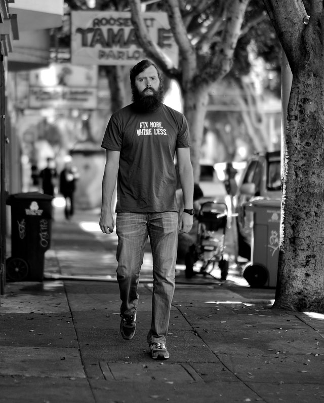 """Fix More, Whine Less"" does this t-shirt say on 24th Street in San Francisco. Leica M9 with Leica 50mm Noctilux-M ASPH f/0.95 and B&W 8X ND-filter"