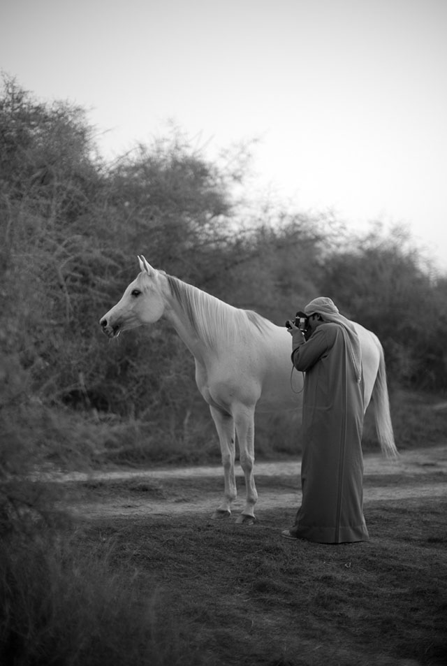 Khalid Al Thani photographing a horse in the low sunset light with a Visoflex lens on the Leica M9