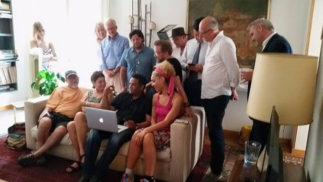 Viewing the photos from the day in our Rome Workshop apartment by the Spanish Steps in Rome.
