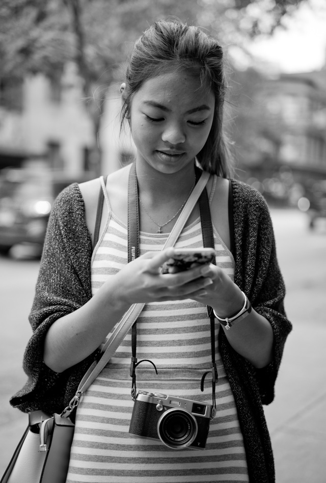 Girl out and about with her Fuji in Vancouver. Leica M-D 262 with Leica 50mm APO-Summicron-M ASPH f/2.0. © 2016 Thorsten Overgaard.