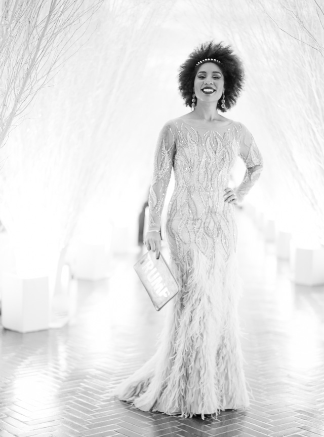 Joy Villa with a new TRUMP clutch made for the occasion, in the East Colonnade of glistering wintery branches. The East Wing had been decorated with stars; one for each Gold Star family, honoring the men and women of the Armed Forces. Dress by Balizza of Milano. © 2017 Thorsten von Overgaard.