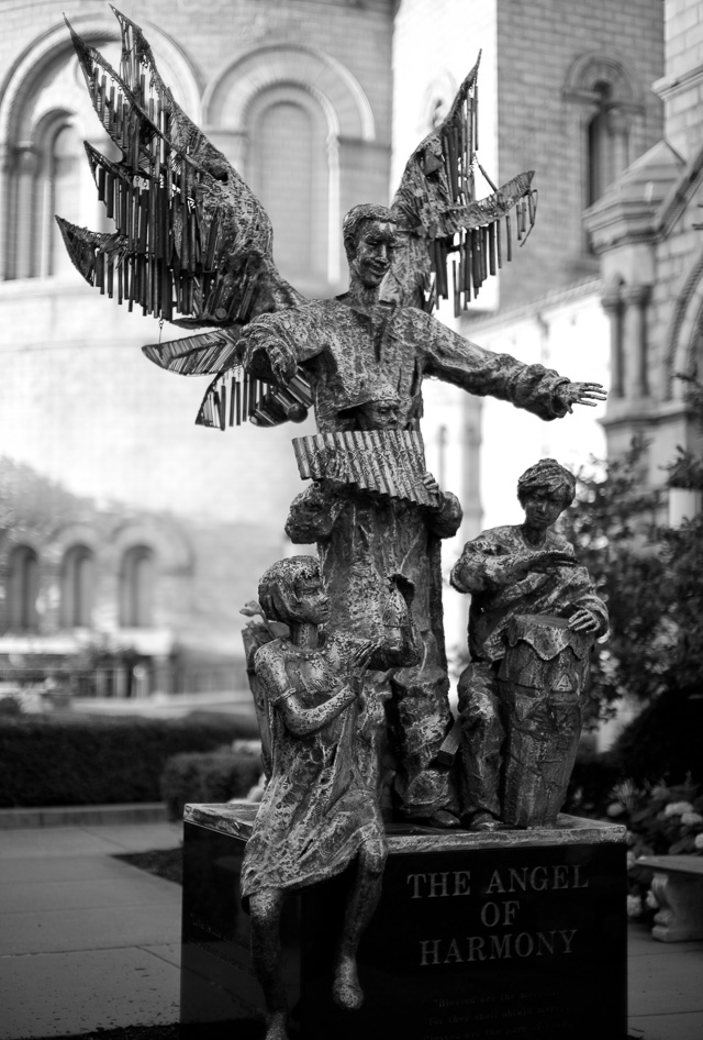"""The Angel of Harmony"" scuplture symbolizing racial justice (1999) by Wiktor Szostalo by the Cathedral Basilica of Saint Louis on Lindell Blvd. The cathedral is an impressive building with beautiful grounds around it. Leica M10 with Leica 50mm Noctilux-M ASPH f/0.95. © 2018 Thorsten von Overgaard."