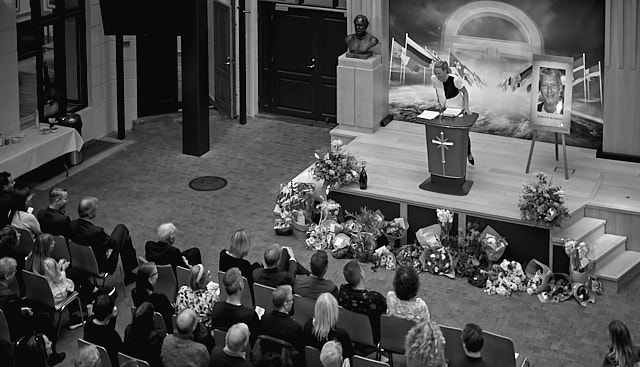 Goodbye to Jørgen Madsen: If your life was a party, the funeral can be a blast. Many friends were sharing stories from a rich life of Jørgen Madsen at the memorial in Church of Scientology in Copenhagen, making the farewell the party he had requested. In this photo Stinne Danneskjold Siracusano is telling about when Jørgen was traveling on an airplane, getting into the trouble you can only dream of: A stellar moment in aviation history and typical of Jørgen's life. There was many grand moments in his life, fast uphill and roaring downhill, making the farewell an uplifting remembrance. Leica M10-P with Leica 50mm APO-Summicron-M ASPH f/2.0. © Thorsten Overgaard.