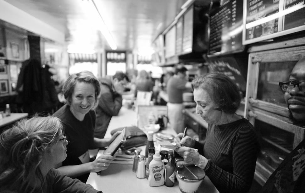 Saturday morning inside Charlie's Sandwich Shoppe. This place is just around the corner of where I stay in Boston and has become part of my morning ritual. The chef there has three old Leica M3, M2, IIIf cameras and 15 lenses from back when that he will send me more on so we can get him upgraded to Leica M9 or something  The place features great food, resulting in a waiting line outside on Saturdays. Obama was here, and so was Al Gore and Sammy Davis Jr.. Charlie's is also known for serving Afro-American musicians when nobody else would, back when. Leica M 240 with Leica 21mm Summilux-M ASPH f/1.4. Thorsten Overgaard © 2014