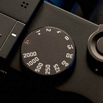 Shutter speed dial  The shutter speed dial can be left at A (aperture priority) and the Leica Q2 will suggest a shutter speed to get the exposure right.   If you want to 'go manual' and set the shutter speed manually you simply turn the shutter speed dial to the desired speed.  The mechanical shutter speed goes to 1/2000th of a second, but the Leica Q2 can go to 1/20,000th of a second with the internal electronic shutter that will take over if needed (when there is a lot of light).