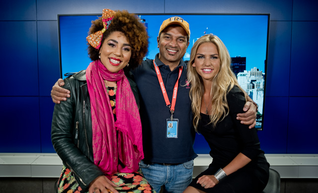 Joy Villa with OANN host Claire Hardwick and cameraman inthe middle.