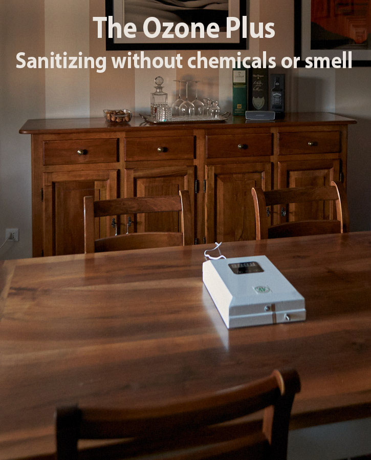The OZONE Plus room sanitizing machine on the dining table in a private home. You turn it on with a timer for 20-25 minutes and will sanitizes all surfaces and remove odor. While it is working, people and animals should not be in the room.