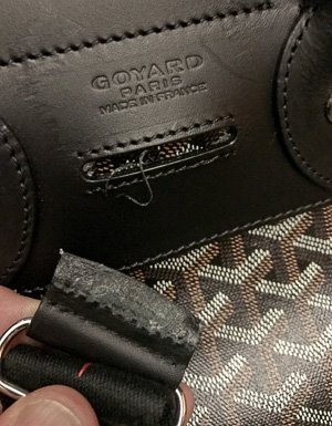 The broken strap for the Goyard Alpin. It couldn't hold a backpack loaded with 8 kilos (16 pounds).