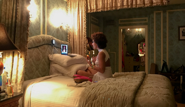 Behind the scenes: Joy Villa doing a YouTube video update to her followers after coming back from the Oscars afterparty.
