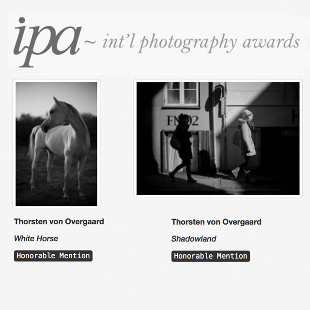 "Two photographs by Thorsten Overgaard , ""Shadowland"" and ""White Horse"" won Honorable Mentioning in IPA Awards 2017 - Photographer of the Year competition."