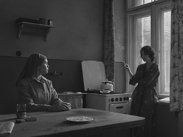 Edge light defines the cigarette smoke and the face by the table, as well as other shapes in the room. If you imagine you and your camera are standing by the window, there would no edge light, instead it would be soft light with lower contrast. Ida (2013, directed by Pawel Pawlikowski, cinematography by Ryszard Lenczewski and Lukasz Zal).