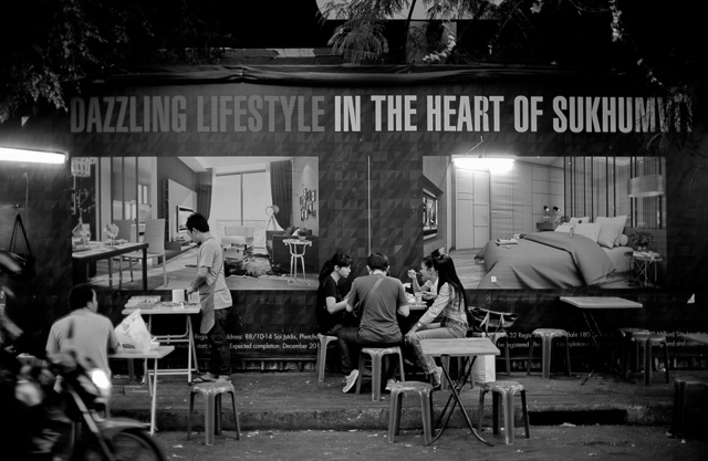 Dazzling Lifestyle in Bangkok, Thailand. A street restaurant with a poster behind for an upcoming luxory building. Leica M 240 with Leica 50mm Noctilux-M ASPH f/0.95.