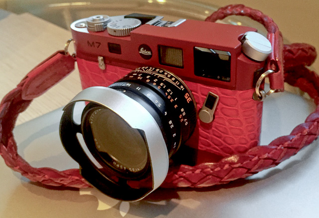 Red Leica M7 with red, red, red. That guy has some balls. Leica 35mm FLE with ventilated lens hood.