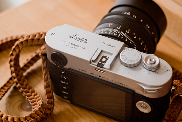 A classic Leica engraving with Made in Germany and the serial number applied to the silver chrome Leica M 240. This camera is with a Leica 50mm Noctilux-M ASPH f/0.95 lens and an Annie Barton braided strap in natural leather.