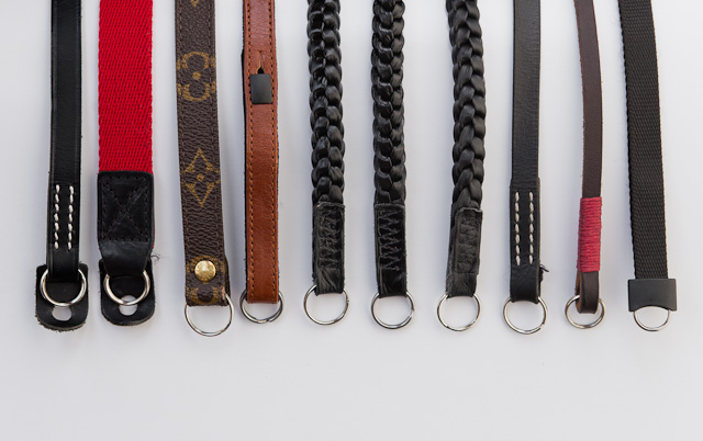 A cavalcade of camera straps for the Leica M. From left A&A 250, A&A, Louis Vuitton, Leica A la Carte in brown, Annie Barton glossy black x 2, Annie Barton matte black, A&A 252, Gordy's camera strap, and finally to the right, the standard Leica camera strap that comes with the Leica M 240, Leica M9 and Leica M9-P (The Leica M Monochrom comes with a black leather strap not shown here. It can be bought as a spare part from any Leica Store).