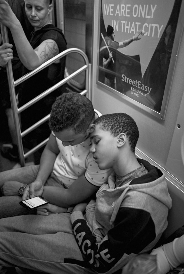 Brothers on the train uptown in New York. Leica M Monochrom with Leica 28mm Summilux-M ASPH f/1.4. © Thorsten Overgaard.