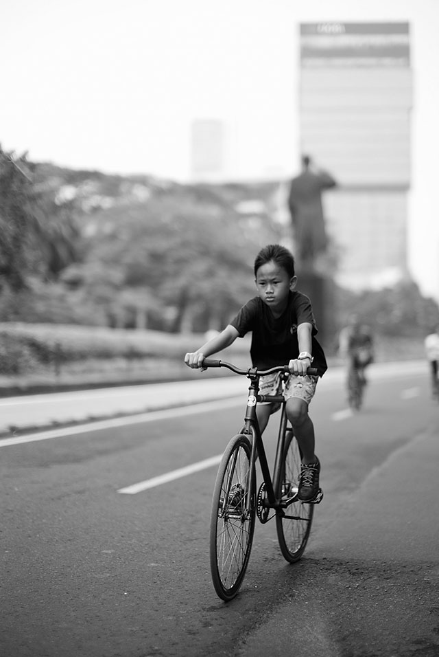 """The Future of Jakarta"". Sunday is car-free day on some of the busy mainroads in Jakarta. Leica M 240 with Leica 50mm Noctilux-M ASPH f/0.95. © 2013 Thorsten Overgaard."