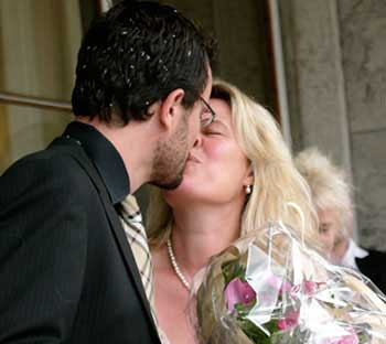 A first kiss as a married couple - with rice in the hair