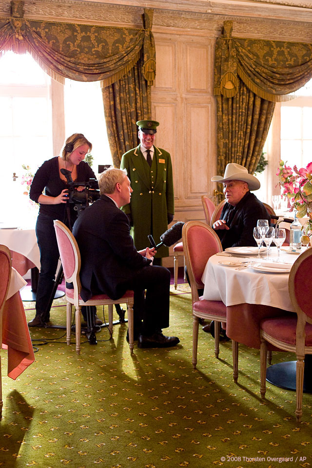 American actor Tony Curtis being interviewed at The Herrods in London by Niel Sean of FOX Entertainment and Emma Brumpton, October 2008
