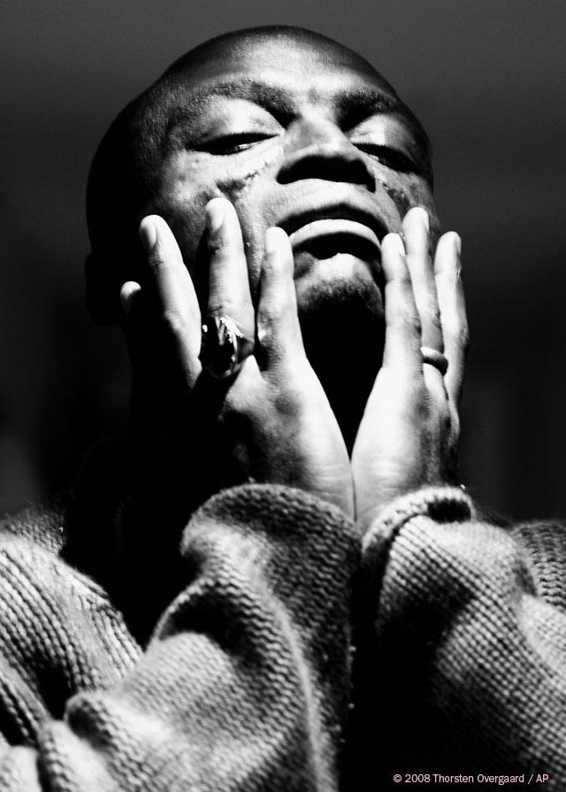 "British soul singer and songwriter Seal in an exclusive photo session at The Soho Hotel in London, promoting his new album ""SOUL,"" October 2008 (AP Photo/Thorsten Overgaard). Leica R8 DMR with Leica Vario-Elmarit-R 35-70mm f/2.8, 200 ISO, 1/15 sec (with mirror up which create more movement of the camera as the mirror and camera is shooting in turn, fast after each other). Converted to b&w (and contrast increased dramatically) in Hasselblad/Imacon FlexColor 4.6 RAW converter. © Thorsten Overgaard."