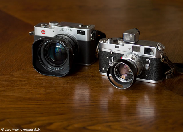 Leica Digilux 2 next to the Leitz M4 in chrome from 1974. The lens is the 50mm Summicron-M f/2.0 and I've kept a 21mm viewfinder on top of the M4 to make a point.