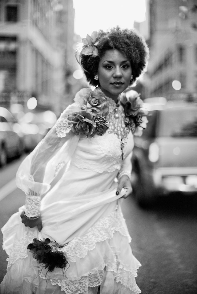 American singer and model Joy Villa, New York, August 2012. Leica M9 with Leica 50mm Noctilux-M f/1.0. External light meter to get the face and dress right despite ever-changing headlights of approaching cars and a sun setting in the horizon.