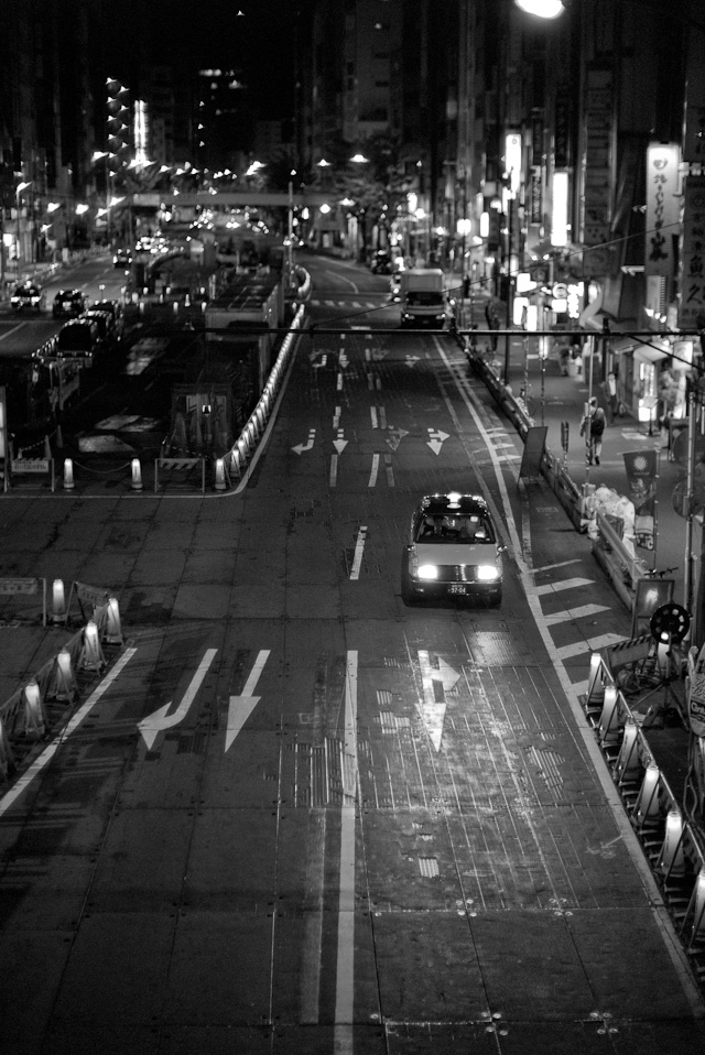 After midnight in Tokyo: The every-ongoing roadwork in one of the busiest Tokyo crossings to keep it running smoothly. Leica M Monochrom with leica 50mm Noctilux-M f/1.0, 3200 ISO.