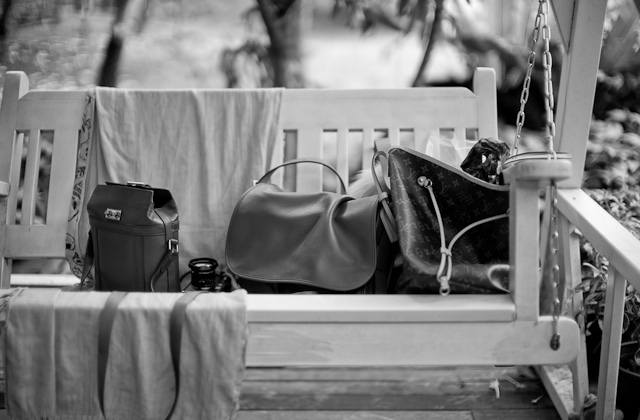 Camera bag nirvana ... Louis Vuitton Binocular Bag, Hermès Barda and Louis Vuitton Neverfull taking rest on a bench.