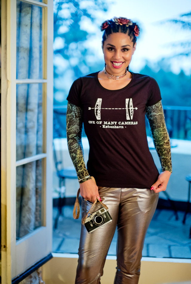 "Joy Villa in Hollywood in a cool t-shirt from ""One of Many Cameras"" in Copenhagen, Denmark (and my beloved Leica M4). They're sort of a Punk-Rock Leica Dealership that sells a lot of large format equipment as well. Leica M10 with Leica 50mm Noctilux-M ASPH f/0.95 FLE. © 2017 Thorsten Overgaard."