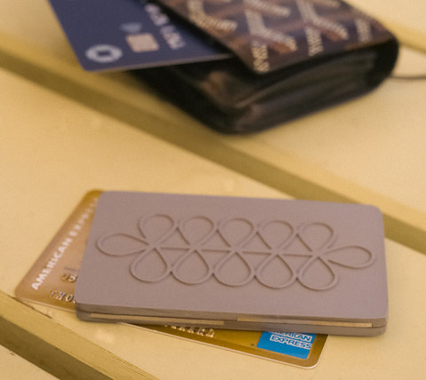 The 5G Protection Card is thicker and heavier than a credit card. Fits in some wallets, but else carry it in a pocket or the bag.