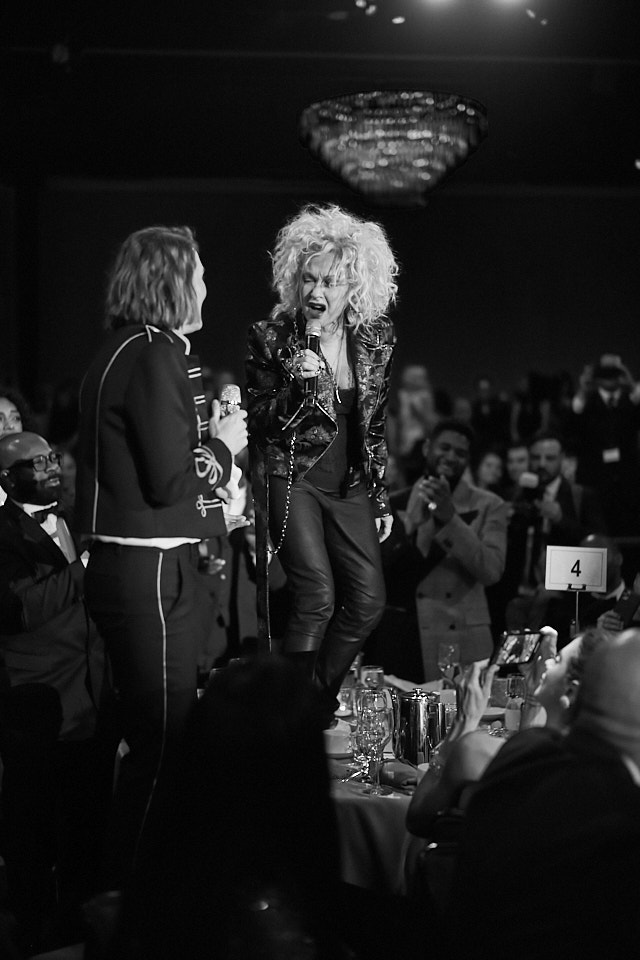Brandi Carlile and Cyndi Lauper dancing on the tables at the Clive Davis Pre-Grammys Gala 2020. Leica M10-P with 50mm Summilux-M ASPH f/1.4 BC. © Thorsten Overgaard.
