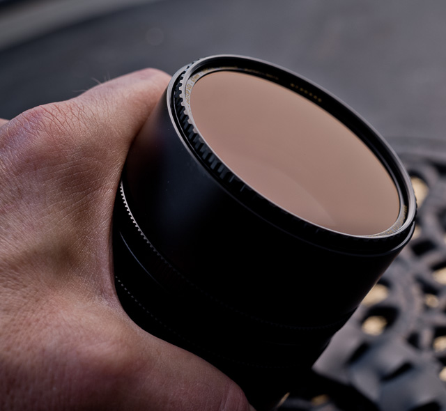 "The 3-stop ND-filter reduces the light going throiug the lens 3 stops, so wide open, when the lens is in fact at f/1.25, it will take light in as if it was at f/3.4 while the lens remains the narrow depth of field of f/1.25. I recommend ""X4-ND"" 3-stop filters from Breakthrough Photography."