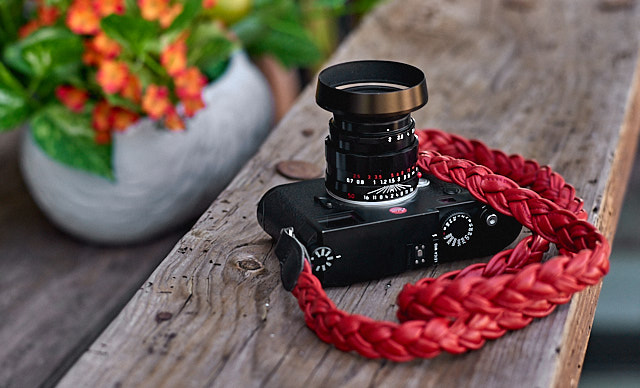 Here's another of the Leica M10 with a red Napa Strap from www.rocknrollstraps.com. Lens is the 50mm APO-Summicron LHSA-edition in black, with my own designed ventilated shade E39 (the one the LHSA-edition comes with is brass and a little bulky).