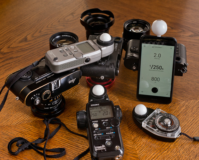 "Some of the external light meters that exist. A good light meter is one that has a white bubble on it so you can measure the light in front of the subject (you hold the bubble where the subject is and the light meter reads how much light there is and calculates the shutter speed and aperture based on that - very precise!). © 2017 Thorsten Overgaard. See my article, ""Using an external light meter for accurate, failproof metering"" for more on external light meters."