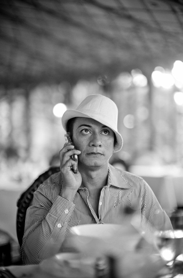 Andre Soriano on the phone to request to loan a sewing machine. Leica M 240 with Leica 50mm Noctilux-M ASPH f/0.95.