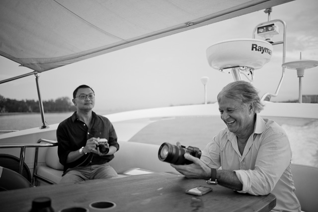 "Boat trip on the ""Ovulation""The boat was amped up on cameras. Here's the SL in the hands of Christopher Wilson with Mr. Charles Koh in the background. Leica M 240 with Leica 28mm Summilux-M ASPH f/1.4. © 2015 Thorsten Overgaard."