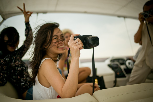 "Boat trip on the ""Ovulation"" of Mr. Gordon Tan and Alicia Koo to see Singapore from the water in the sunset. Here it's Alice with one of the many Leica Q cameras on board. Leica M 240 with Leica 28mm Summilux-M ASPH f/1.4. © 2015 Thorsten Overgaard."