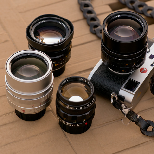 The Noctilux 'King of the Night' lens. From left the 0.95 in silver (same on the camera, in black, the f/1.0 in the back and the rare and expensive first model, the f/1.2 in the front.