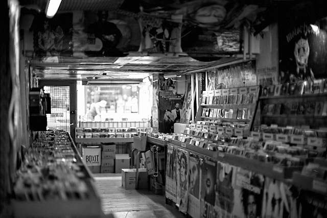 One of the oldest - and still remainning - record stores inn Denmark. Pladekisten. Held together with old music posters and Scotch tape. Leica M10-P with Leica 50mm Noctilux-M ASPH f/0.95. © Thorsten Overgaard.