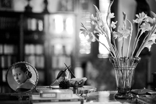 Depth of Field: Focus is on the flowers and the photograph on the desk and the foreground and background is blurred as the depth of field is narrow. If one stop down the aperture of the lens from f/1.4 to f/5.6, more will be in focus. If one stop down the lens to f/16 even more (if not all) will be in forcus. Another rule: The closer you go to a subject (the less focusing range), the more narrow the Depth of Field will be. © 2017 Thorsten Overgaard.