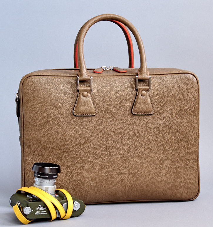"The Von camera bag in light brown Taupe is called ""Tokyo"" and is made of soft Italian calfskin."