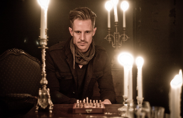 Actor Jason Dohring caught in a dark room lit by only candle lights. TIFFEN Pro Mist 1 filter on Leica 50mm Summilux-M ASPH f/1.4. © Thorsten Overgaard.