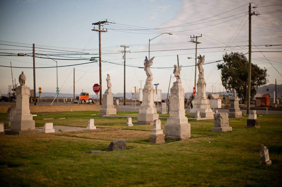 Crossroads: In a traffic crossing in City of Guadalupe in California, angels watching over the dead, electricity lines, telephone lines and trucks meet in a surreal symphony. Leica M 240 with Leica 50mm Noctilux-M ASPH f/0.95. Thorsten Overgaard © 2014.