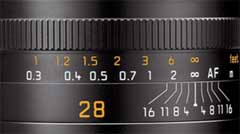 The lines on this 28mm lens indicates the DOF. Here the focus is on infinity, and if the lens is stopped down to f/1.6, objects from 1.8 meter to ininity will be 'acceptable sharp'.