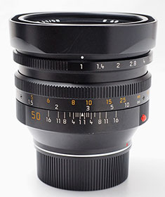 The Leica Noctilux-M f/1.0 (1993-08) with 60mm filter thread and built-in plastic shade.
