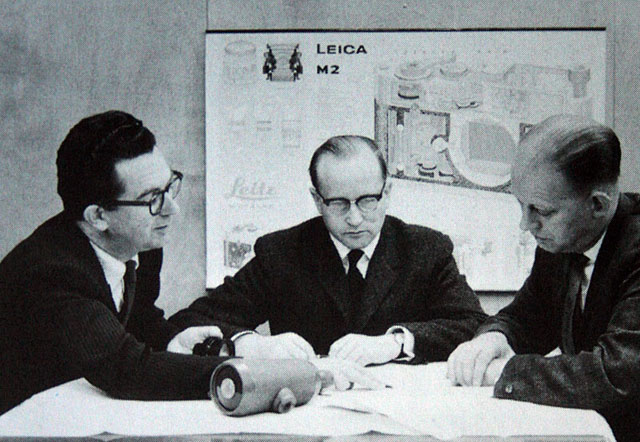 Dr. Walter Mandler (center) at the Ernst Leitz Camera factory.